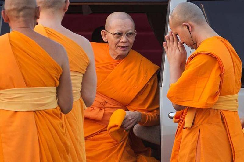 File- Abbot Phra Dhammachayo (C) arrives for a ceremony at the Wat Phra Dhammakaya temple in Pathum Thani province, north of Bangkok on Makha Bucha Day, on March 4, 2015. Photo: Reuters