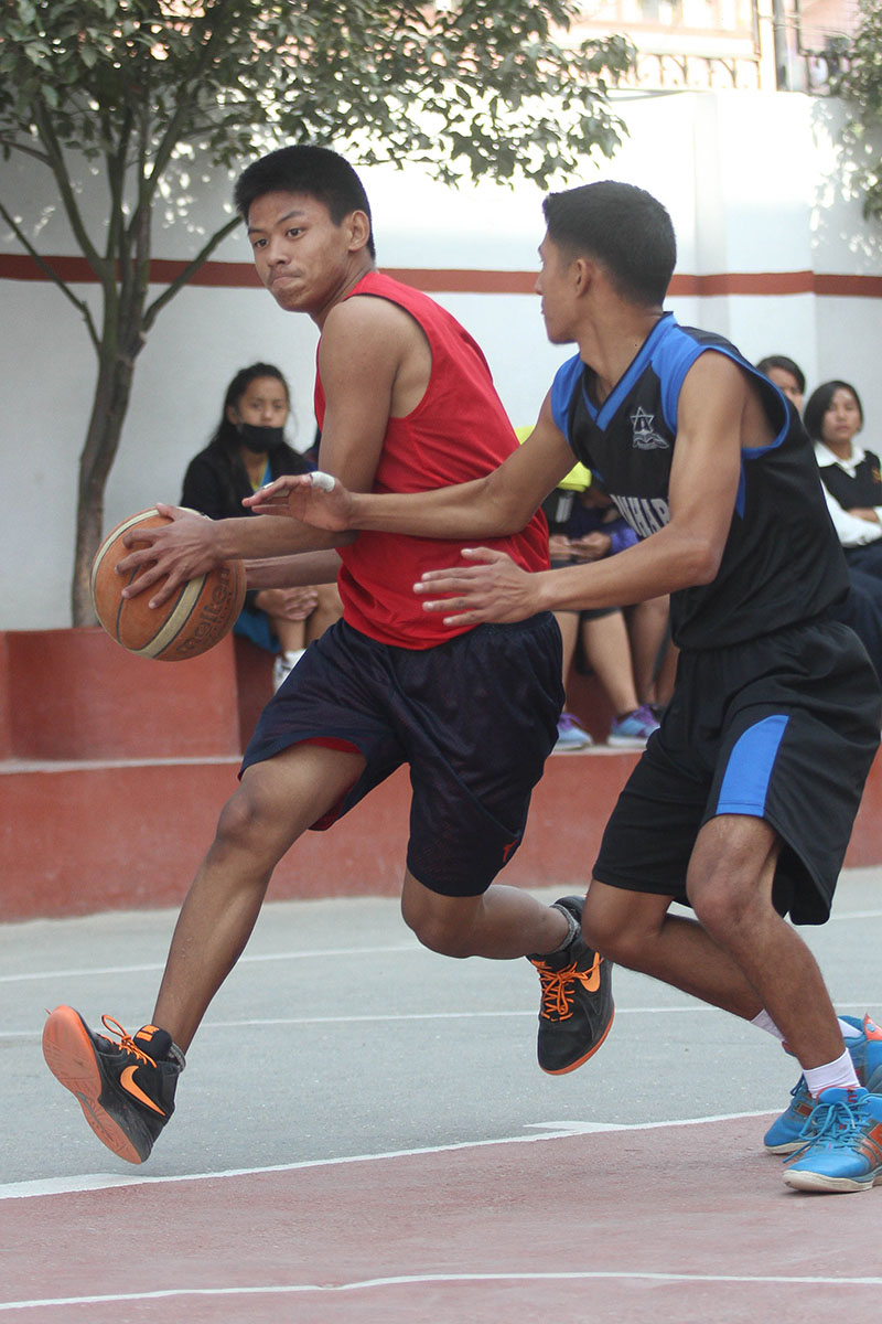 Players of Xavier and BernHardt (right) in action during their Rosebud Basketball Tournament match in Kathmandu on Monday, November 28, 2016. Photo: Udipt Singh Chhetry/THT