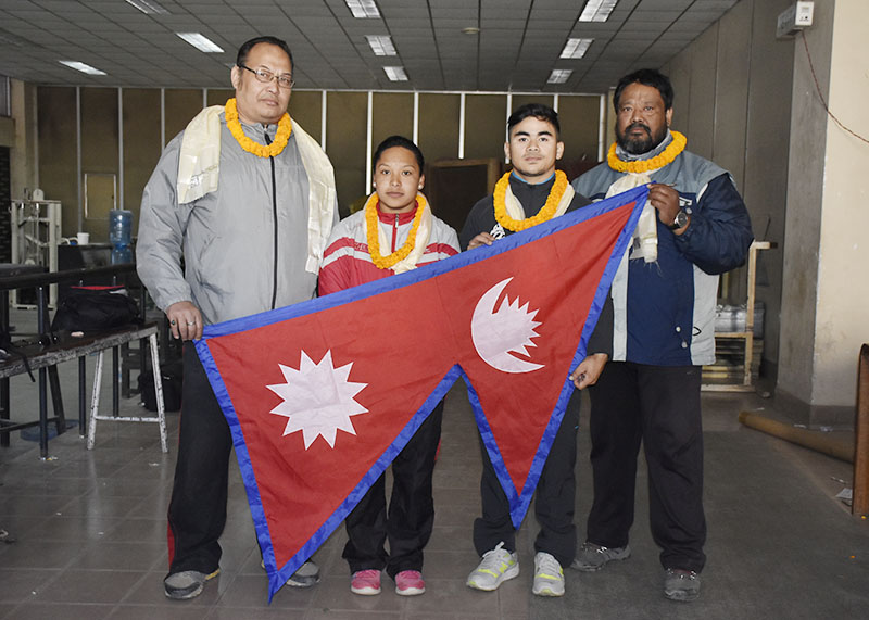 Nepali lifters Prakash KC and Kamala Shrestha pose for a photo with coach Sunil Lal Joshi (left) and team manager Sanjay Maharjan during their farewell in Lalitpur on Sunday, November 6, 2016. Photo: THT