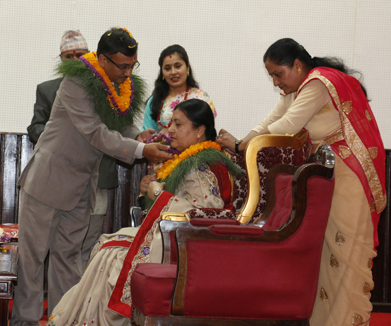 President Bidya Devi Bhandari receives tika and garland from his younger brother Degendra Pandey on the auspicious occasion of Bhaitika at the Presidential Palace, Sheetal Niwas, on Tuesday, November 1, 2016. Photo: RSS