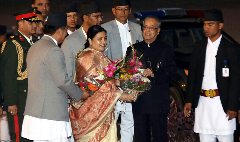 President Bidya Devi Bhandari presents a bouquet to her Indian counterpart Pranab Mukherjee as she sees him off at the VVIP lounge of the Tribhuvan International Airport, in Kathmandu, on Friday, November 04, 2016. Photo: RSS