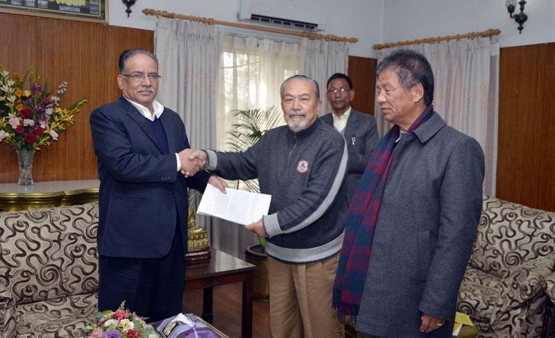 Prime Minister Puspa Kamal Dahal receives a memorandum from Indigenous Nationalities National Movement Chairman Padma Ratna Tuladhar at Baluwatar in Kathmandu on Sunday, November 27, 2016. Photo: PM's Secretariat