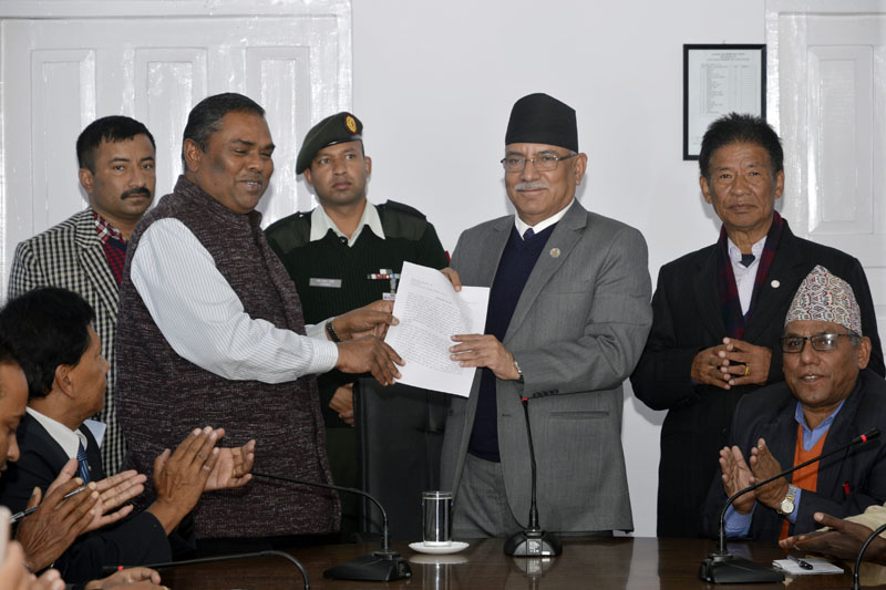 FILE: Prime Minister Pushpa Kamal Dahal receives a memorandum from Federal Socialist Forum-Nepal Chair Upendra Yadav, on behalf of the Federal Alliance, at Baluwatar, in Kathmandu on Monday, November 14, 2016. Photo: PM's Secretariat