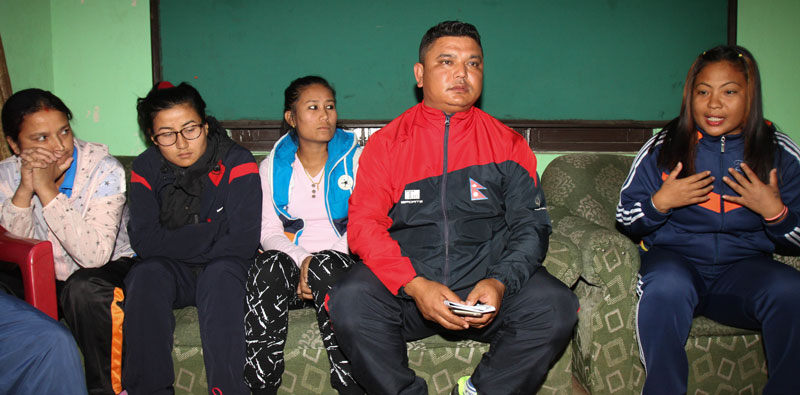 Womenu2019s national cricket team member Nary Thapa (right) speaks as coach Raju Basnyat and other players look on during a press conference in Kathmandu on Tuesday. THT