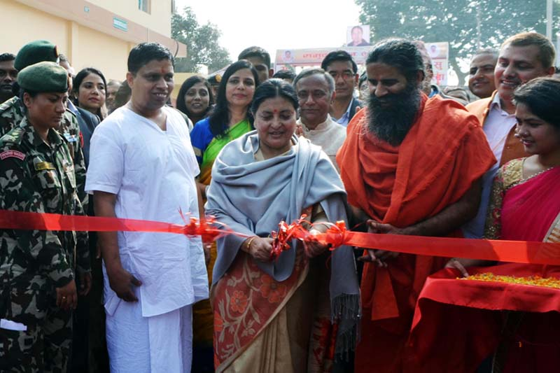 President Bidya Devi Bhandari inaugurates the Patanjali Ayurved Udyog Pvt Ltd, to be operated by the world famous yoga guru, Baba Ramdev (right to her), of India, in Prauni-9 of Bara district, on Thursday, November 24, 2016. Photo: Ram Sarraf