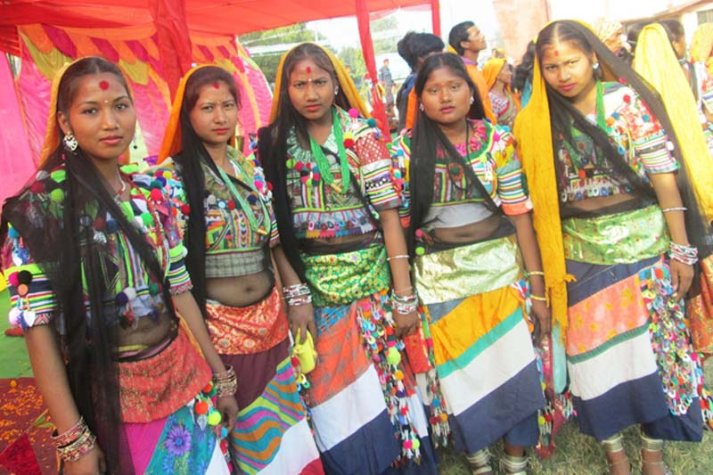 Women from the Rana Tharu community pose for a photograph in their traditional attires during a function in Kailali district, on Thursday, November 24, 2016. Photo: RSS