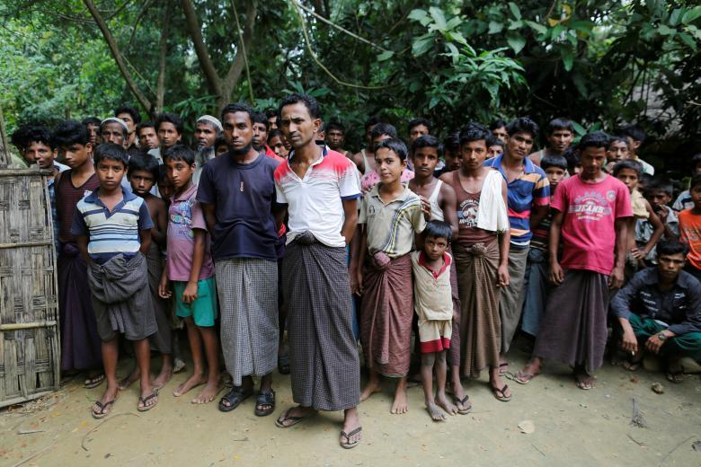 Rohingya Muslim men stand at U Shey Kya village outside Maugndaw in Rakhine state, Myanmar October 27, 2016.  REUTERS/Soe Zeya Tun