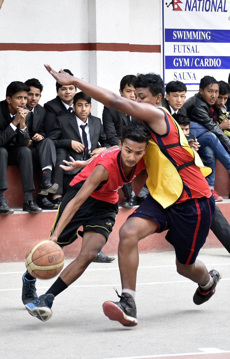 Players of Rosebud (left) and CCRC vie for the ball during their Rosebud Basketball Tournament match in Kathmandu on Sunday, November 27, 2016. Photo: THT