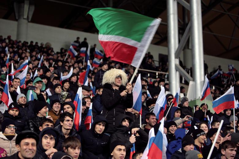 Football Soccer - Russia v Romania - International Friendly - Akhmat Arena, Grozny, Russia - 15/11/16. Fans of Russia wave flags. REUTERS/Kazbek Basayev