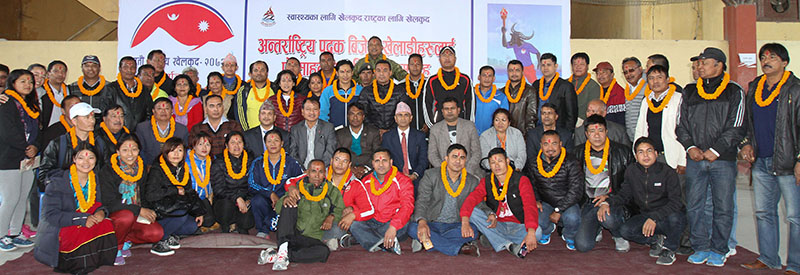 SA Games gold medallists and Asian Games medal winners pose for a photo with Minister for Youth and Sports Daljit Sripaili and other officials in Kathmandu on Monday, November 28, 2016. Photo: Udipt Singh Chhetry/THT