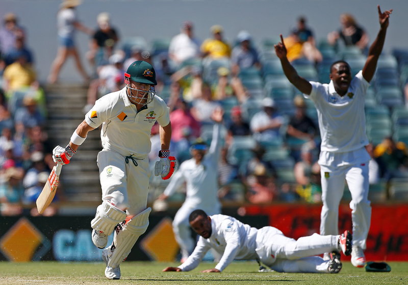 Australia's David Warner is run out by South Africa's Temba Bavuma at the WACA Ground in Perth. Photo: Reuters