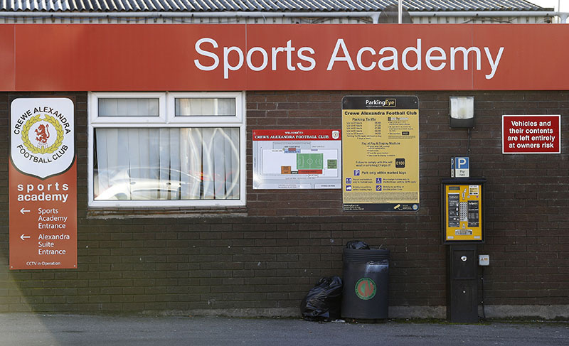A sign for the sports academy of the English soccer team Crewe Alexandra at the Alexandra Stadium, in Crewe northern England, on Friday November 25, 2016. Photo: Martin Rickett/PA via AP