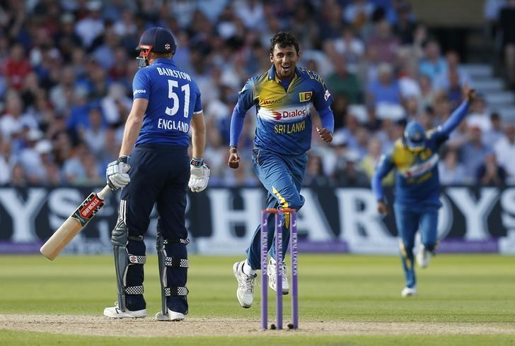 Britain Cricket - England v Sri Lanka - First One Day International - Trent Bridge - 21/6/16nSri Lanka's Suranga Lakmal celebrates taking the wicket of England's Jonny Bairstow (L)nAction Images via Reuters / Ed SykesnLivepic/Files