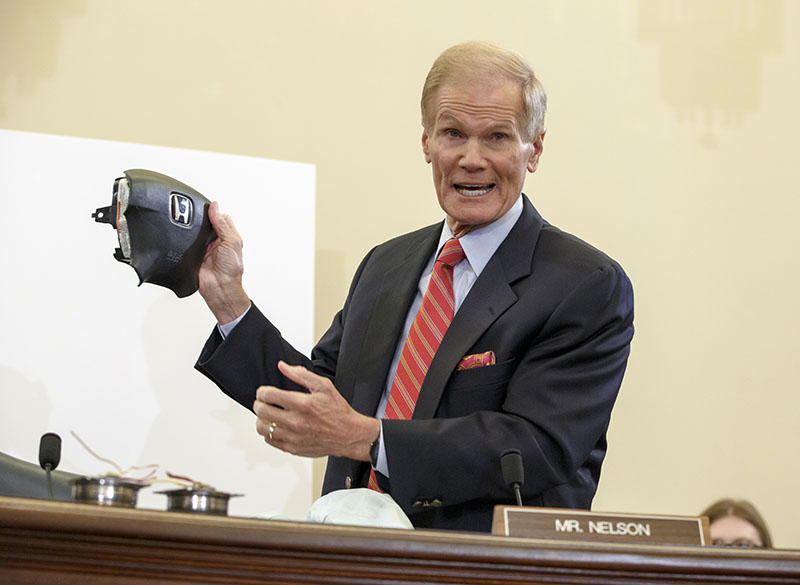 FILE - Senate Commerce Committee member Senator Bill Nelson, D-Florida, displays the parts and function of a defective airbag made by Takata of Japan that has been linked to multiple deaths and injuries in cars driven in the United States, during the committee's hearing on Capitol Hill in Washington, on Thursday, November 20, 2014. Photo: AP