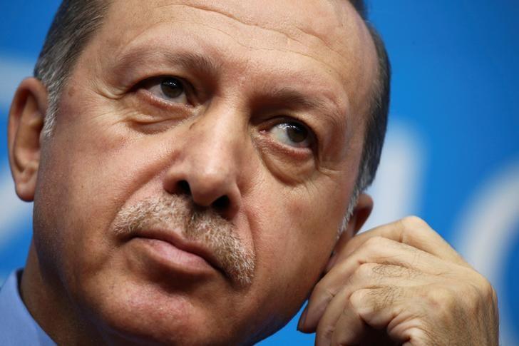 Turkey's President Tayyip Erdogan adjusts earphones during a news conference in Hangzhou, Zhejiang Province, China, September 5, 2016.   REUTERS/Damir Sagolj/File Photo