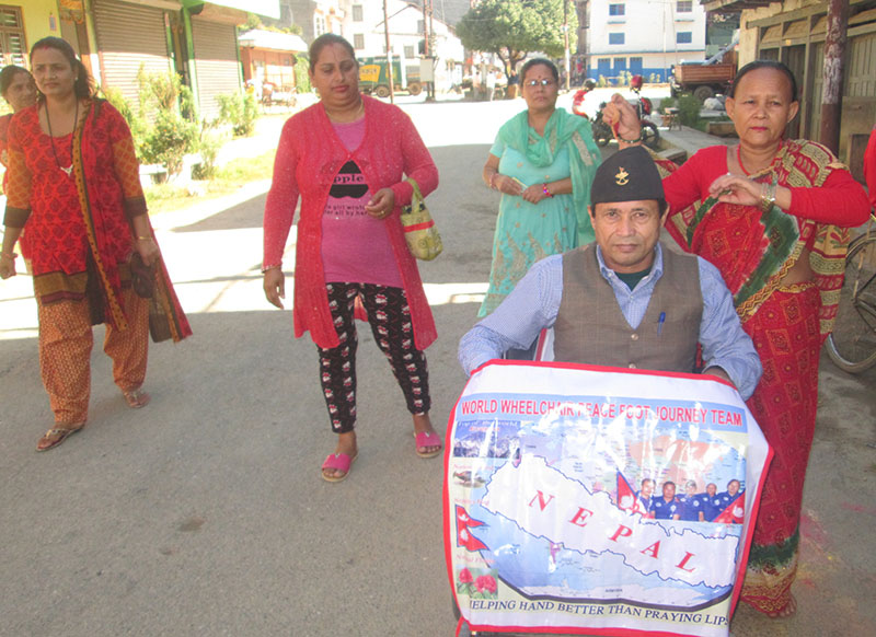 Tej Bahadur Karki, a disabled person who is on a nationwide tour, in Damauli, on Saturday, November 5, 2016. Photo: THT