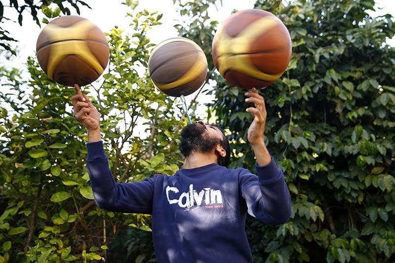 Thaneswar Guragai of Nepal spins three basketballs simultaneously to claim the title for longest basketball spinning time, on the occasion of Guinness World Records Day at Sherpa Khangri in Panipokhari, Kathmandu, on Thursday, November 17, 2016. Photo: Skanda Gautam/THT