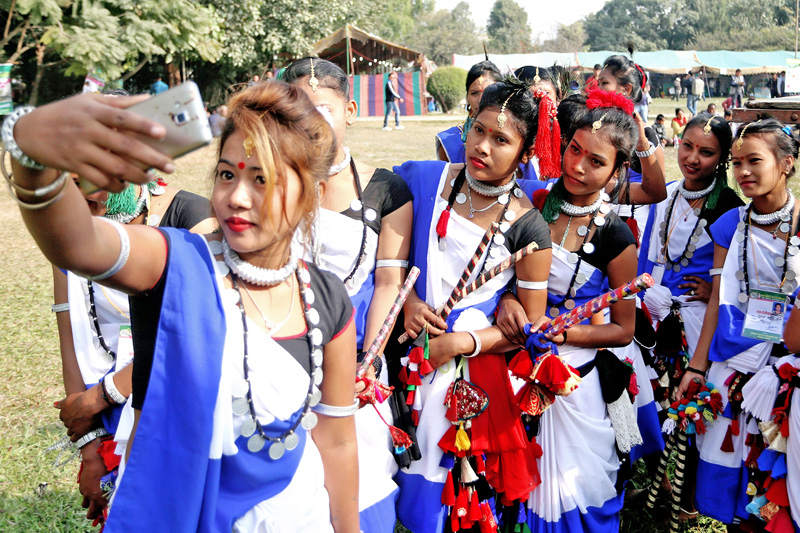 Artists from the Tharu community pose for a selfie after performing their play at the 14th Competitive Handicraft Exhibition in Kathmandu, on Friday, November 25,2016. Photo: RSS