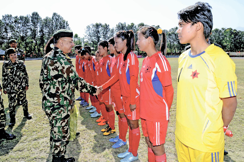 Chief of the Army Staff Gen Rajendra Chhetri shaking hands with TAC players during the inauguration ceremony of the CoAS fourth International Womenu0092s Football Tournament at the Nepali Army Sports Complex in Lalitpur on Friday, November 4, 2016. Photo: THT