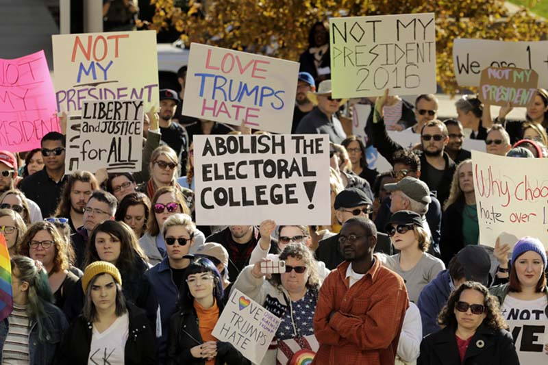 People protest against the election of President-elect Donald Trump in front of City Hall in Kansas City, Missouri, on Saturday, November 12, 2016. Photo: AP