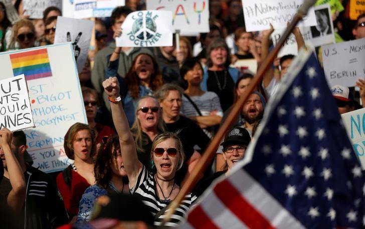 Demonstrators gather at the Utah State Capitol building in protest to the election of Republican Donald Trump as President of the United States in Salt Lake City, Utah, U.S. November 12, 2016.  REUTERS/Jim Urquhart