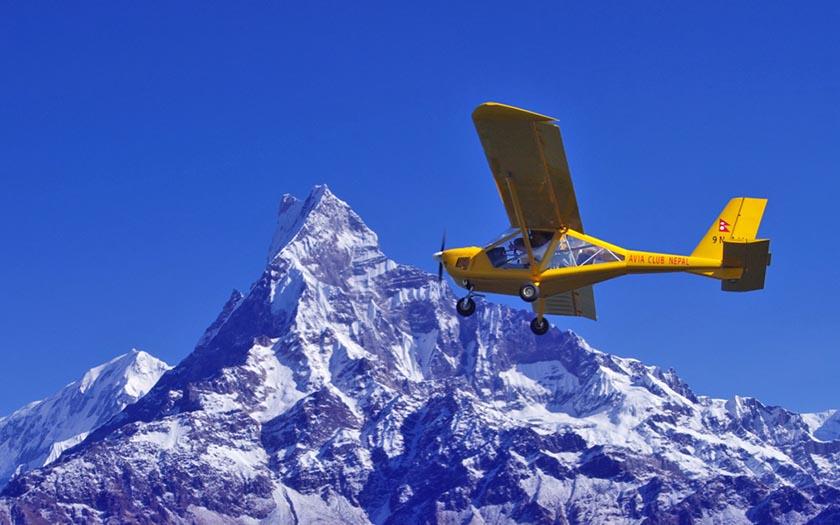FILE - An Ultralight aircraft is seen flying near Mt Machhapuchhre. Photo: Avia Club Nepal