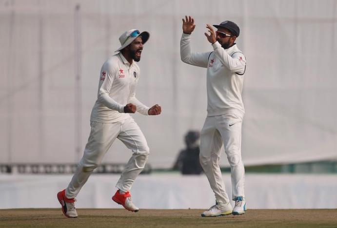 Cricket - India v England - Third Test cricket match - Punjab Cricket Association Stadium, Mohali, India - 29/11/16. India's Virat Kohli and Ravindra Jadeja (L) celebrate the dismissal of England's Jos Buttler. REUTERS/Adnan Abidi
