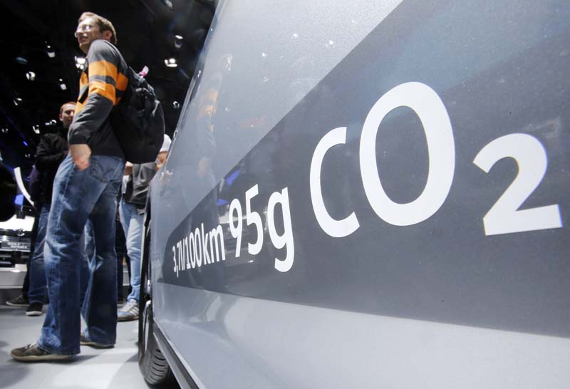 File- The amount of carbon dioxide emissions is written on a Volkswagen Passat Diesel at the Frankfurt Car Show in Frankfurt, Germany, on September 22, 2015. Photo: AP