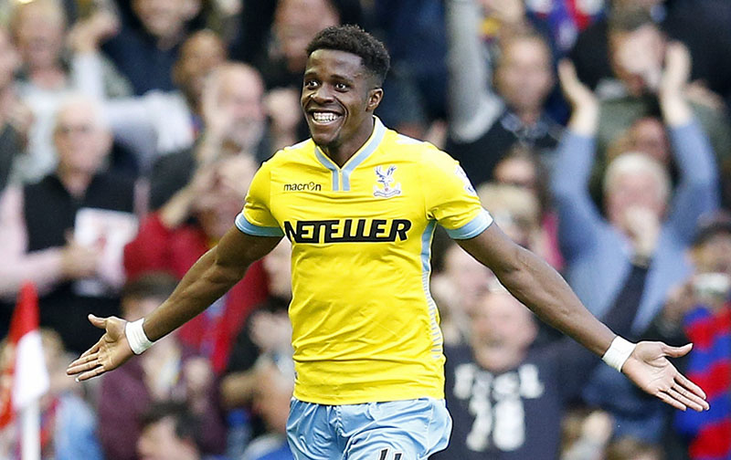 FILE - Crystal Palace's Wilfried Zaha celebrates after scoring his side's second goal during the English Premier League soccer match between Liverpool and Crystal Palace at Anfield Stadium, Liverpool, England, on Saturday, May 16, 2015. Photo: AP