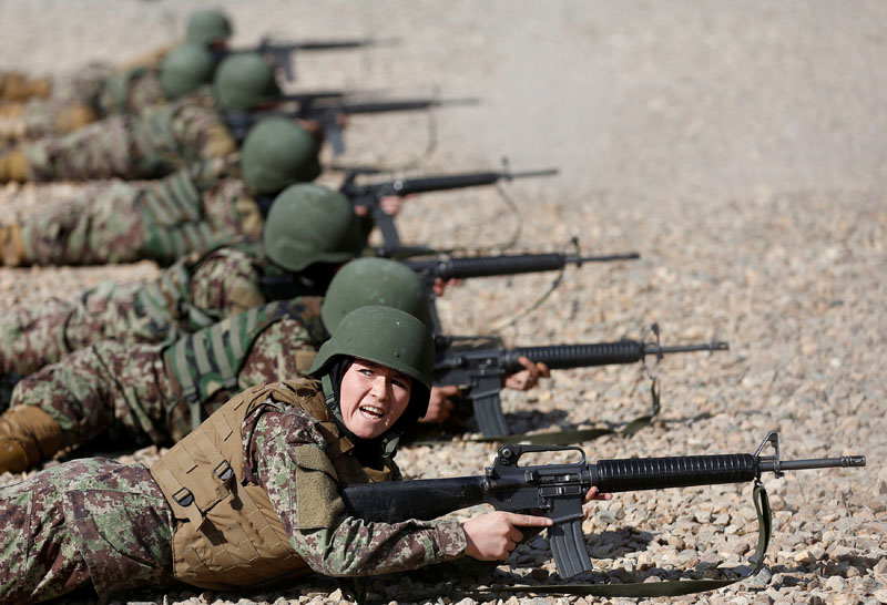 Sabera, 23, a soldier from the Afghan National Army (ANA) gestures during a shooting exercise at the Kabul Military Training Centre (KMTC) in Kabul, Afghanistan, on October 26, 2016. Photo: Reuters