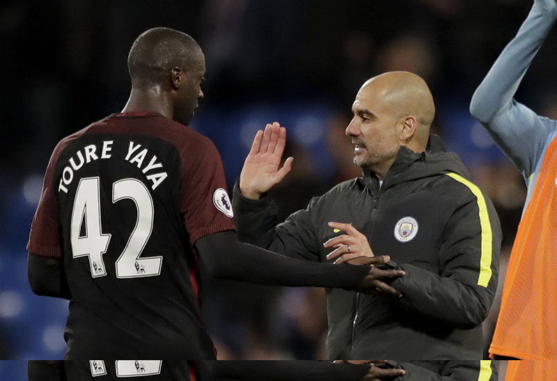 Manchester City's Yaya Toure, who scored both their goals, celebrates with his head coach Pep Guardiola after the English Premier League soccer match between Crystal Palace and Manchester City at Selhurst Park stadium in London, on Saturday, November 19, 2016. Photo:AP