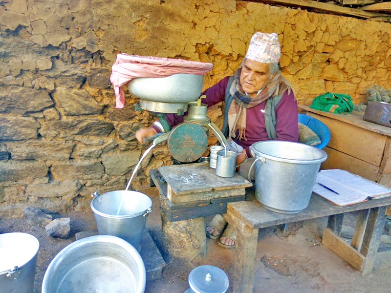 A local man working at his home-based dairy farm in Namsaling of Ilam district, on Friday, November 25, 2016. Photo: RSS