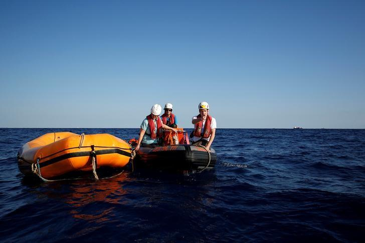 Aid workers from the aid group Sea-Watch carry out training drills off the coast of Malta in preparation for a mission in the Mediterranean to search for migrants attempting to reach Europe by boat from the Libyan coast across the stretch of sea which has become the world's deadliest crossing point for migrants, in Valletta's Grand Harbour, Malta, November 2, 2016. REUTERS/Juan Medina