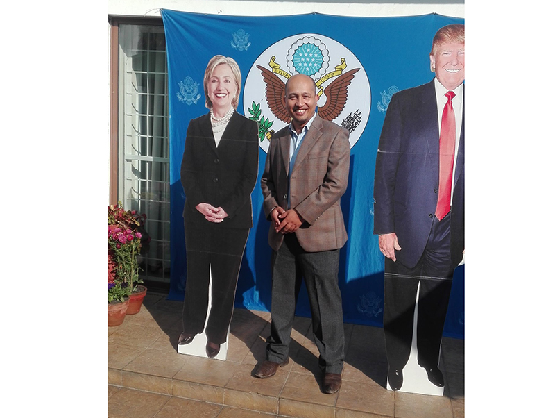 A Nepali citizen poses between two cardboard cutout photos of the two US presidential candidates at the US ambassador's residence in Kathmandu, Nepal, on Wednesday, Nov 9, 2016. The United States is headed for the polls to vote for their new president on Tuesday. Photo: Lekhnath Pandey