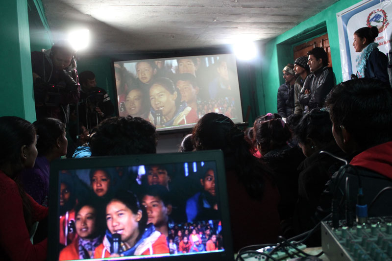 Children from Barpak of Gorkha and Martadi of Bajura interact to each other through video messaging, organised by UNICEF Nepal, on Saturday, November 26, 2016. Photo: UNICEF