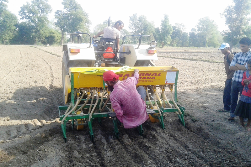 A zero-tillage seed drill is being operated to sow seeds at a farm in Jhalari of Kanchanpur district, on Wednesday, November 16, 2016. Photo: RSS