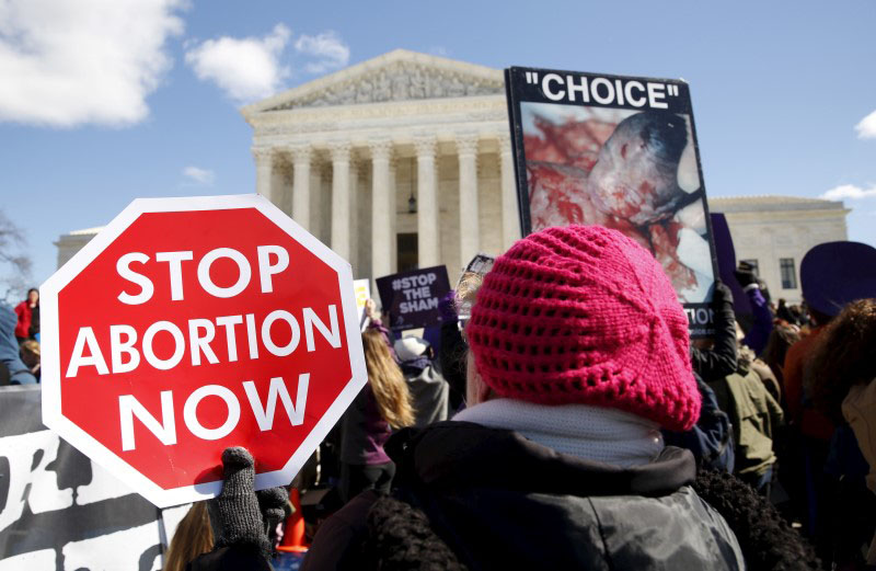 Protesters demonstrate in front of the US Supreme Court on the morning that the court took up a major abortion case focusing on whether a Texas law that imposes strict regulations on abortion doctors and clinic buildings interferes with the constitutional right of a woman to end her pregnancy in Washington March 2, 2016. Photo: REUTERS
