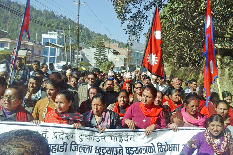 People stage a demonstration in protest of the Constitution amendment bill registered to split some hilly districts from Province No.5, in Sandhikharka of Arghakhanchi district, on Sunday, December 25, 2016. Photo: RSS