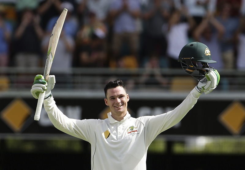 Australia's Peter Handscomb celebrates after scoring his maiden test century during play on day two of the first cricket test between Australia and Pakistan in Brisbane, Australia, Friday, Dec. 16, 2016. Photo: AP