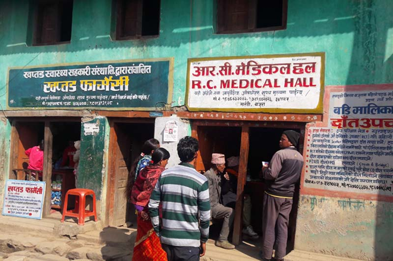 People of Bajura throng a medical store to buy life-saving drugs as the government health facilities fail to provide them for free, in this photo taken in Martadi of Bajura on Sunday, December 11, 2016. Photo: Prakash Singh