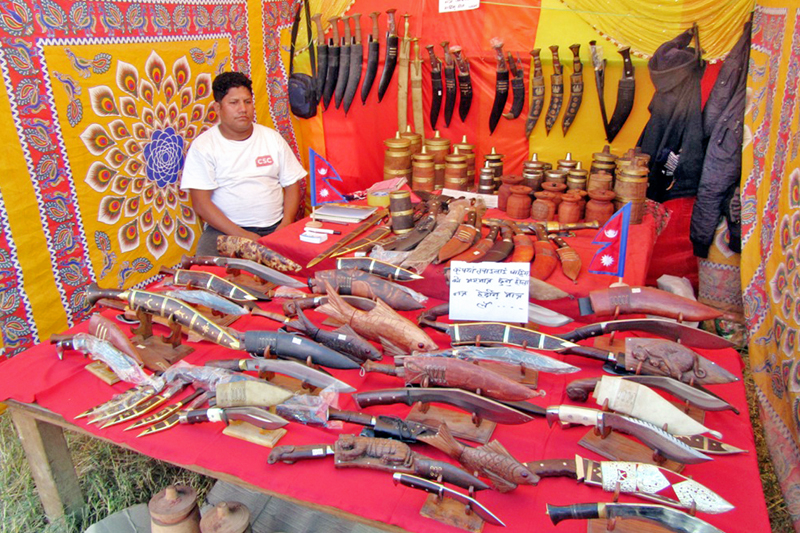 A vendor waits customers as he puts Bhojpure khukuris on sale at the Cottage Industry Trade Fair in Itahari, on Wednesday, December 7, 2016. Photo: RSS
