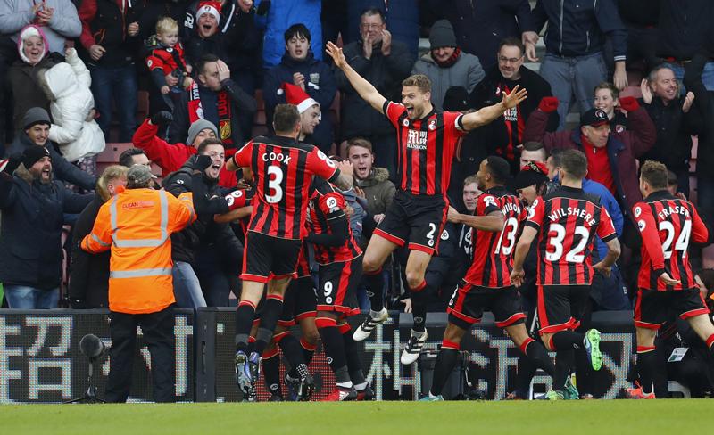Bournemouth's Nathan Ake celebrates scoring their fourth goal with teammates. Photo: Reuters