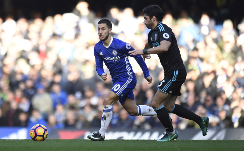 Chelsea's Eden Hazard in action with West Bromwich Albion's Claudio Yacob. Photo: Reuters