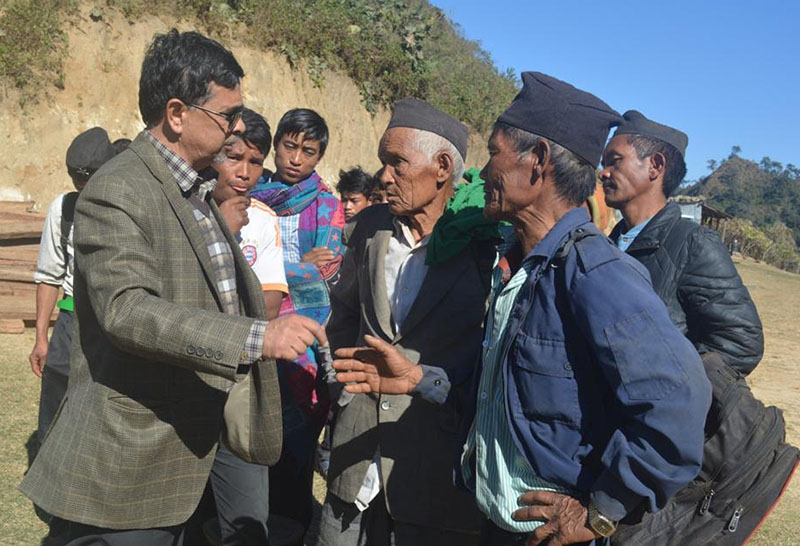 Lawmaker Rajendra Pandey talking to members of the Chepang community, at Mahadevsthan VDC, in Dhading, on Sunday, December 11, 2016. Photo: THT