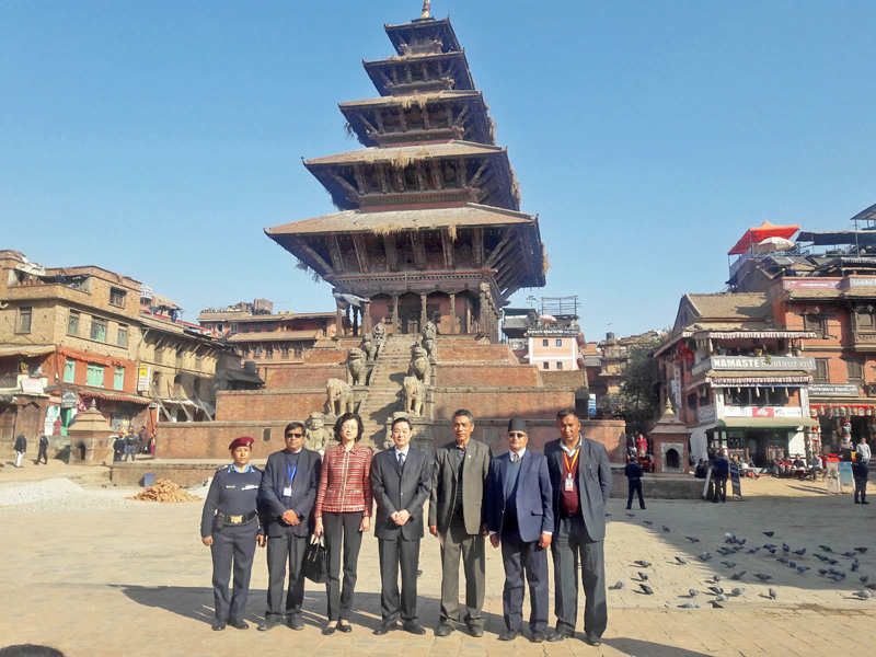A Chinese delegation including Chief of Chinese Communist Partyu0092s Publicity Department, Liu Qibao, and Chinese Ambassador to Nepal, Yu Hong, pose for a photograph along with Nepali officials in front of the historical five-storey Nyatapol Temple, in Bhaktapur, on Monday, December 19, 2016. Photo: RSS