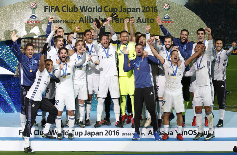 Real Madrid's Sergio Ramos and team mates celebrate winning the FIFA Club World Cup Final with the trophy. Photo: Reuters