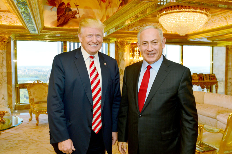 File -  Israeli Prime Minister Benjamin Netanyahu (right) stands next to Republican US presidential candidate Donald Trump during their meeting in New York, on September 25, 2016. Photo: Reuters