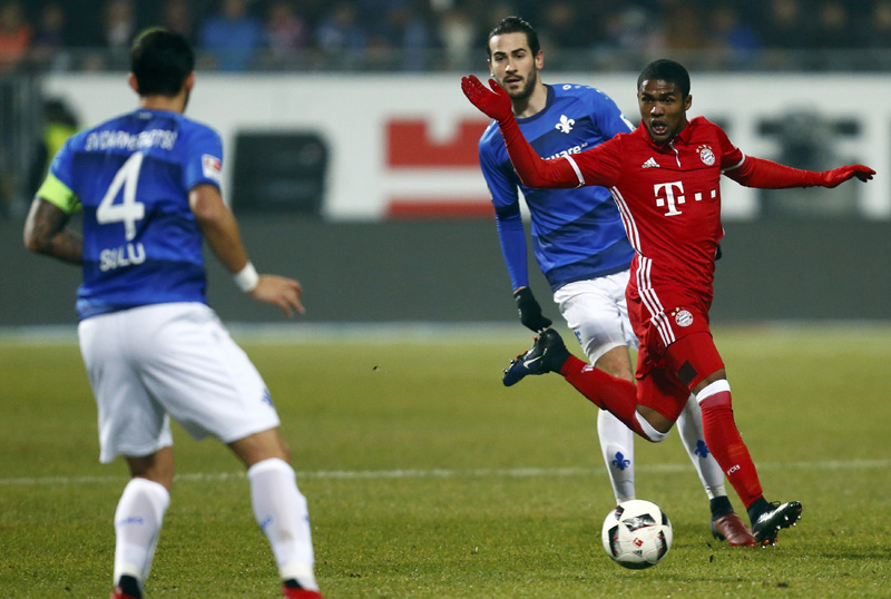 Darmstadt's Mario Vrancic in action with Munich's Douglas Costa. Photo: Reuters