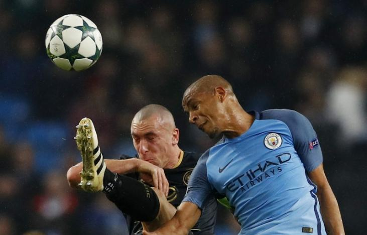 Britain Football Soccer - Manchester City v Celtic - UEFA Champions League Group Stage - Group C - Etihad Stadium, Manchester, England - 6/12/16 Manchester City's Fernando in action with Celtic's Scott Brown  Reuters / Phil Noble Livepic