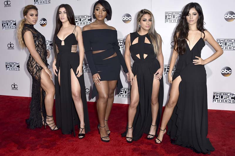 File- Dinah Jane, from left, Lauren Jauregui, Normani Kordei, Ally Brooke, and Camila Cabello, of Fifth Harmony, arrive at the American Music Awards at the Microsoft Theater, in Los Angeles, on November 20, 2016. Photo: AP